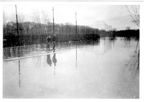 Boys on raft, floating on  flooded tennis courts, 1959. City of Ottawa Archives. (click to enlarge)