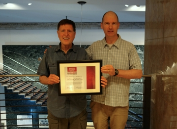 Ed Kucerak and OSCAR Editor Brendan McCoy with the FCA Award for Media Excellence.